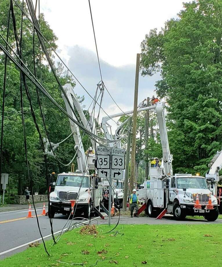 Utility trucks and crews began dealing with a rat's next of wires down near the intersection of Route 33 and 35 in Ridgefield. Eversource is 99percent of customer sin town will have power back by midnight tonight, Tuesday. Photo: Contributed / Hearst Connecticut Media
