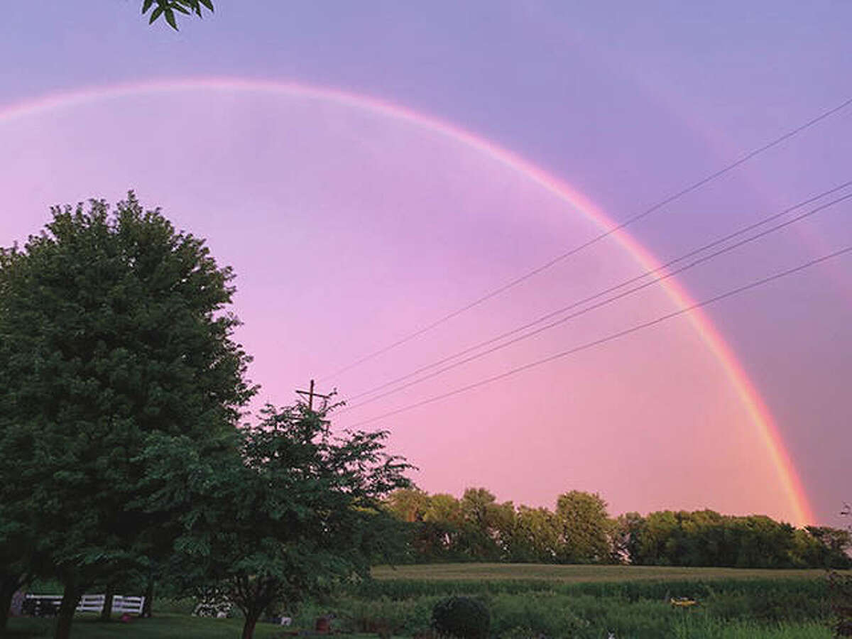 A rainbow fills the southern sky behind after storms pass through. Photo by Libby Davis