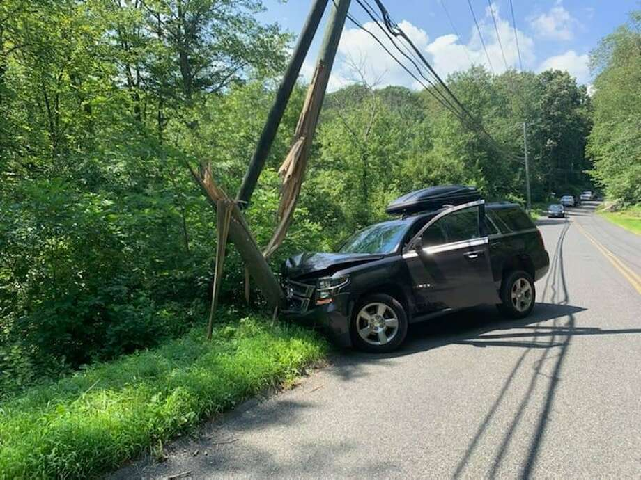 A utility pole was split during a crash on Sport Hill Road in Easton, Conn., on Tuesday, Aug. 11, 2020. Photo: Contributed Photo / Easton Police Department