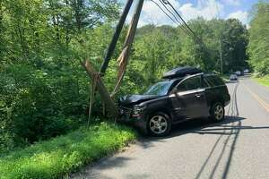A utility pole was split during a crash on Sport Hill Road in Easton, Conn., on Tuesday, Aug. 11, 2020.