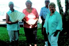 Awards were presented during a recent Spirit of the Woods Garden Club, Inc. meeting. Pictured, (from left) are Lorraine Schwenndner, Patrice Murdock, Mark Schwendner and Nancy Catlett. (Courtesy photo)