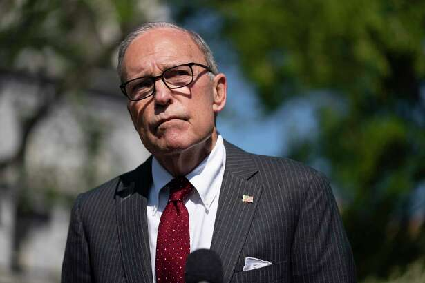White House chief economic adviser Larry Kudlow talks to reporters at the White House on April 6 in Washington.