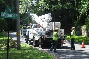 Crews continue to repair downed trees and power lines one week from when Tropical Storm Isaias hit Greenwich, Conn. Tuesday, Aug. 11, 2020. By 4 p.m. Tuesday, about 270 customers in town were without power, down from a high of over 10,100 after the storm hit.