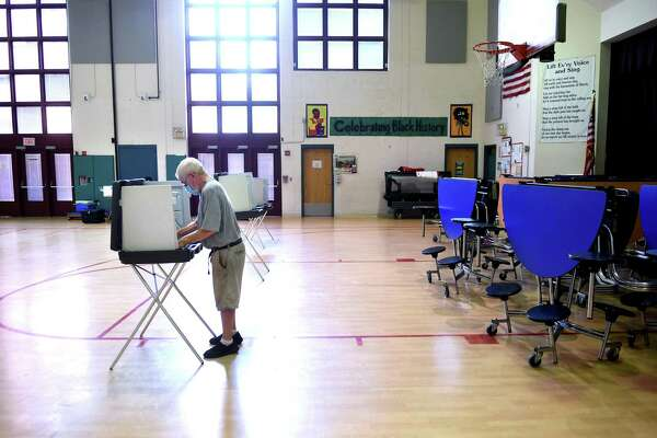 Michael Shanahan votes at Edgewood School in New Haven on Aug. 11, 2020.