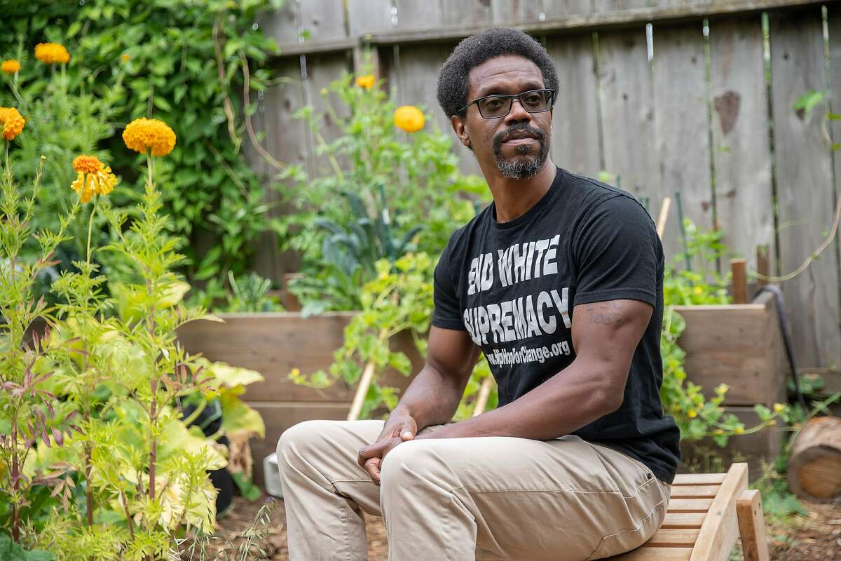 A portrait of Emile DeWeaver at his backyard on Tuesday, Aug. 4, 2020, in Oakland, Calif. DeWeaver is a community organizer, literary writer and journalist who co-founded prisonrenaissance.org. He was formerly incarcerated at San Quentin State Prison. His sentence was commuted by Gov. Jerry Brown in 2017. He went to prison as a young man, convicted of murder, and then grew up in prison, where he grappled with the traumas of his youth while avoiding prison gangs and taught himself to be a writer while spending more than 20 years behind bars.