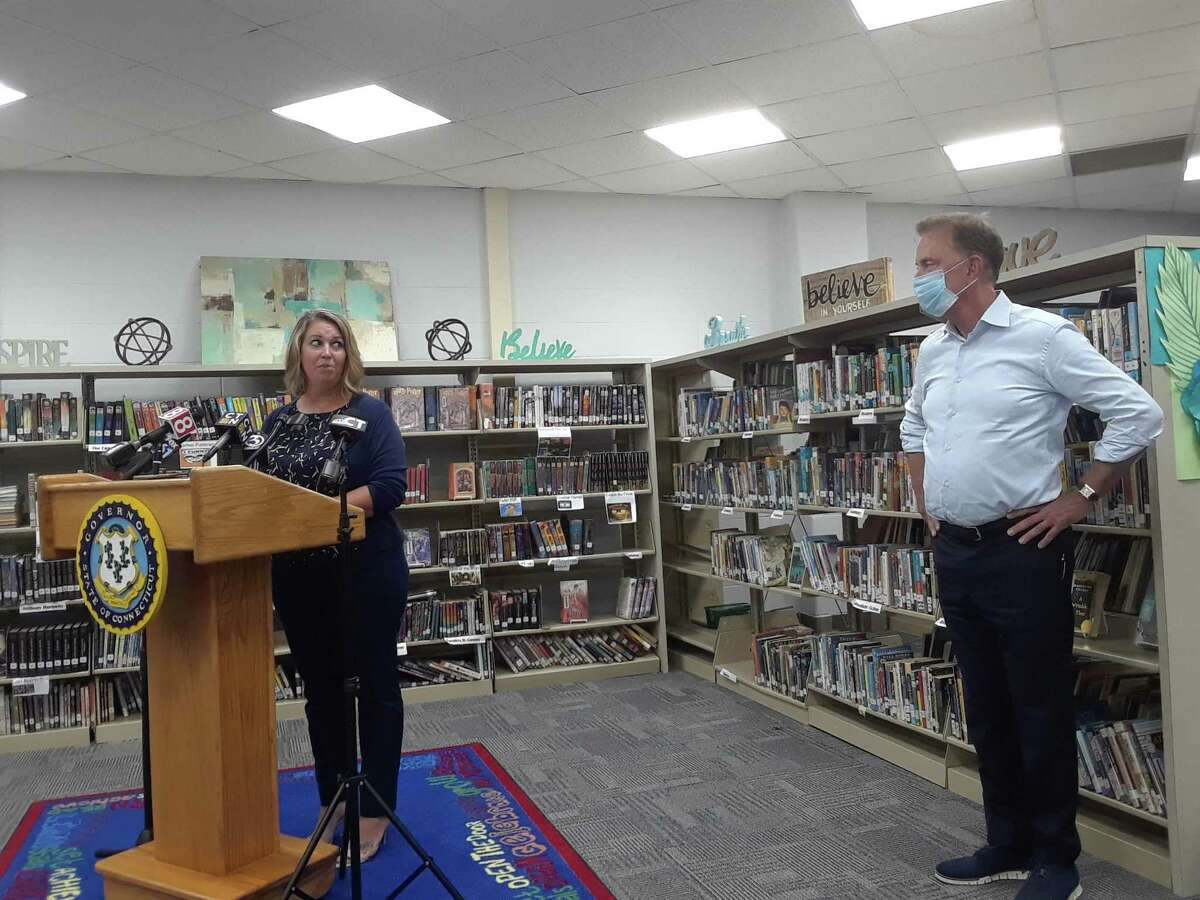 Gov. Ned Lamont and state Education Commissioner Miguel Cardona joined Winchester Public Schools Superintendent Melony Brady-Shanley, Mayor Candy Perez and other state, town and school officials for a round table discussion and press conference Tuesday. Brady-Shanley and a school team are reopening the public schools Aug. 31. Above, Brady-Shanley speaks to Gov. Lamont.