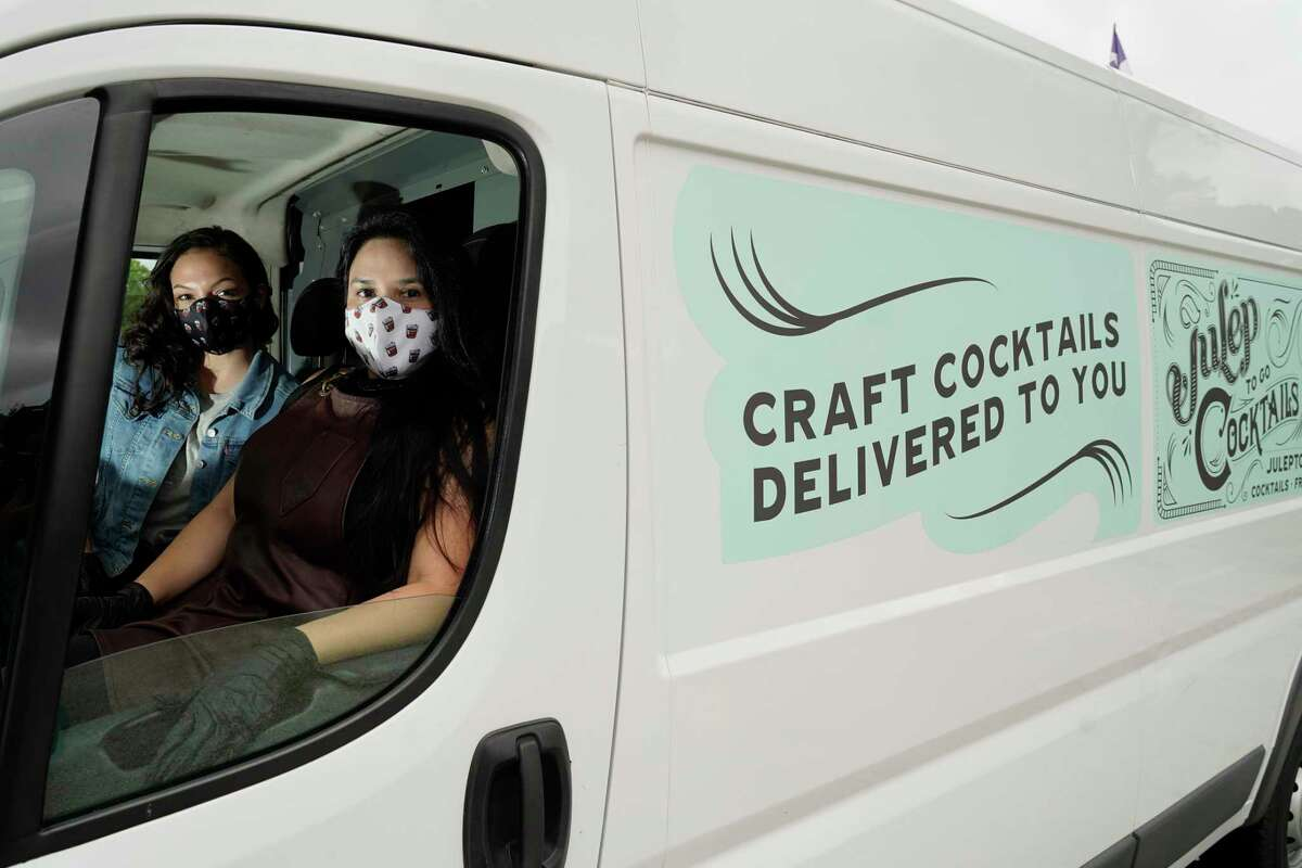 Andrea Irving, bar staff, left, with Alba Huerta, owner of Julep, 1919 Washington Ave., are shown in the cocktail delivery truck she has added to try and survive the bar shutdown amid the coronavirus pandemic shown Saturday, July 25, 2020, in Houston.