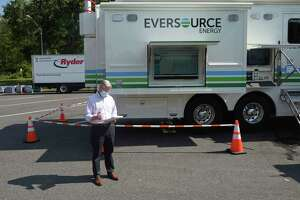 Eversource President of Regional Electric Operations Craig Hallstrom checks his note before speaking to the media at the Eversource satellite command center at the Danbury Welcome Center on I-84 in Danbury, Conn, Tuesday, August 11, 2020.