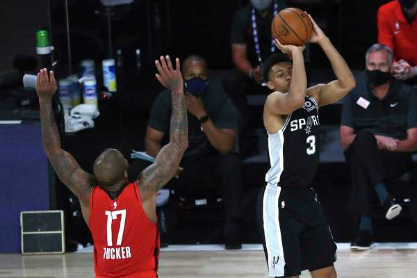 San Antonio Spurs forward Keldon Johnson (3) shoots in front of Houston Rockets forward P.J. Tucker (17) during the second half of an NBA basketball game Tuesday, Aug. 11, 2020, in Lake Buena Vista, Fla. (Kim Klement/Pool Photo via AP)