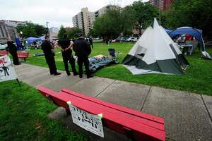 Stamford Police monitor the scene as protesters pack up and breakdown an encampment at Latham Park on July 17, 2020 in Stamford, Connecticut.