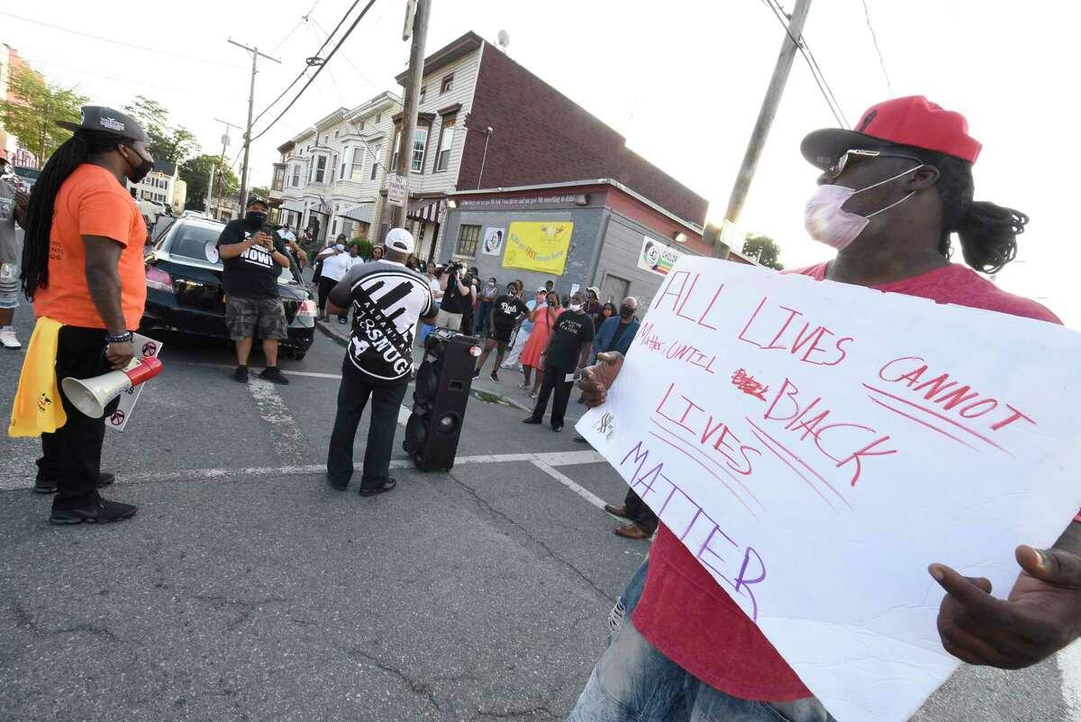 Demonstrators rally at the scene of Saturday's killing of Zy-Quaveone Mayo at the intersection of First and Quail Streets on Tuesday, Aug. 11, 2020 in Albany, N.Y. Mayo, the 18-year-old who was shot and killed on Saturday was the 11th homicide victim this year. (Lori Van Buren/Times Union)