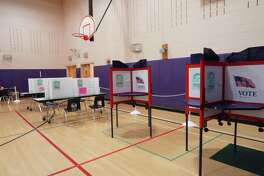 The social distancing precautions taken in New Canaan at Saxe Middle School where district 1 and 2 vote in the primary, were not tested, since voting in person was very quiet on Aug. 11, 2020.