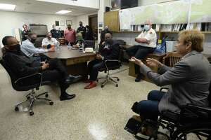 Governor Greg Abbott and local leaders listen as Dr. Qamar Arfeen talks about local cases during a meeting at the Jefferson County Courthouse Tuesday to discuss the status of COVID-19 cases in the area, testing, and other issues. A press conference followed, during which Abbott shared highlights of their conversation and responded to questions regarding state regulations, the economy and testing. Photo taken Tuesday, August 11, 2020 Kim Brent/The Enterprise
