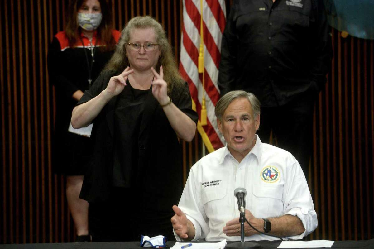 Governor Greg Abbott speaks during a press conference with local officials at the Jefferson County Courthouse Tuesday to discuss the status of COVID-19 cases in the area, testing, and other issues. Photo taken Tuesday, August 11, 2020 Kim Brent/The Enterprise