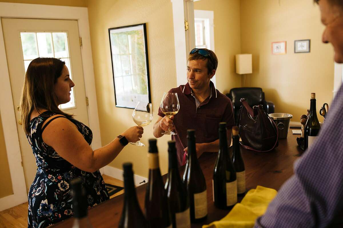 Meg Thering and Trevor Felch taste wines at the Witching Stick tasting room in Philo, Calif., on Saturday, May 26, 2018.