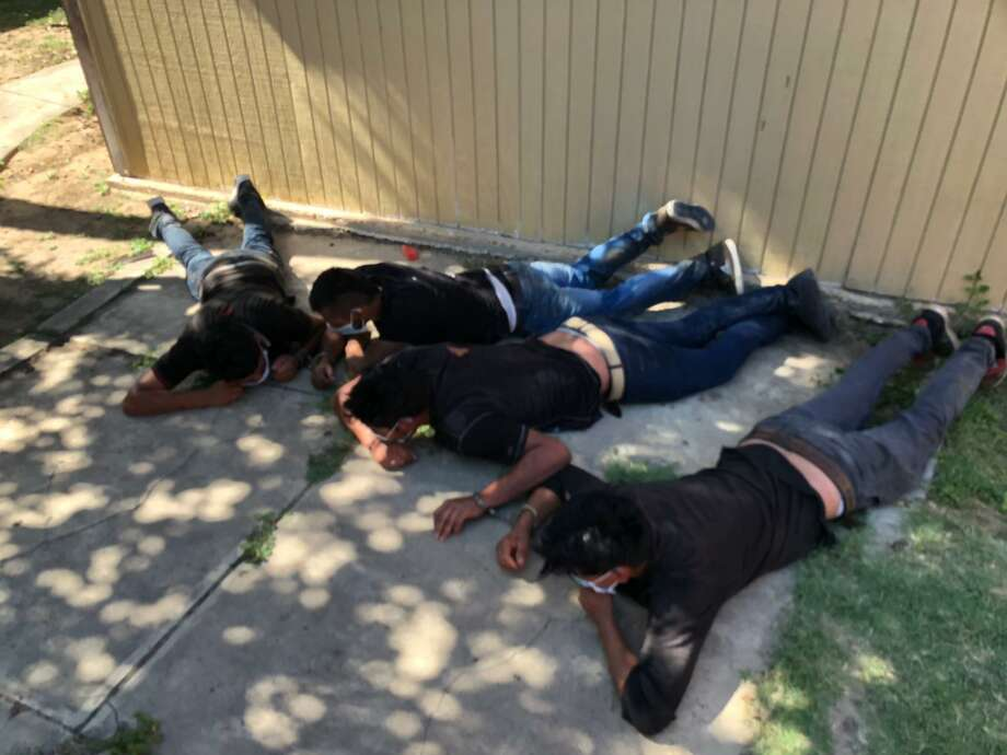 This is part of a group the U.S. Border Patrol and the Texas Department of Public Safety detained in a foiled human smuggling attempt. Authorities arrested the suspect and 12 immigrants who had crossed the border illegally. Photo: Courtesy Photo /U.S. Border Patrol