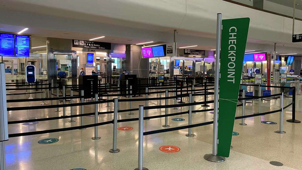 The TSA check-in area is seen in an unusually deserted airport terminal at San Francisco International Airport in San Francisco, California on August 2, 2020 amid the coronavirus pandemic. (Photo by Daniel SLIM / AFP) (Photo by DANIEL SLIM/AFP via Getty Images)