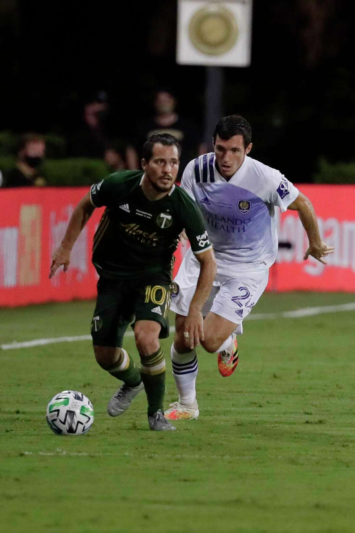 Portland Timbers midfielder Sebastian Blanco (10) outruns Orlando City defender Kyle Smith (24), during the second half of an MLS soccer match, Tuesday, Aug. 11, 2020, in Kissimmee, Fla. (AP Photo/John Raoux)