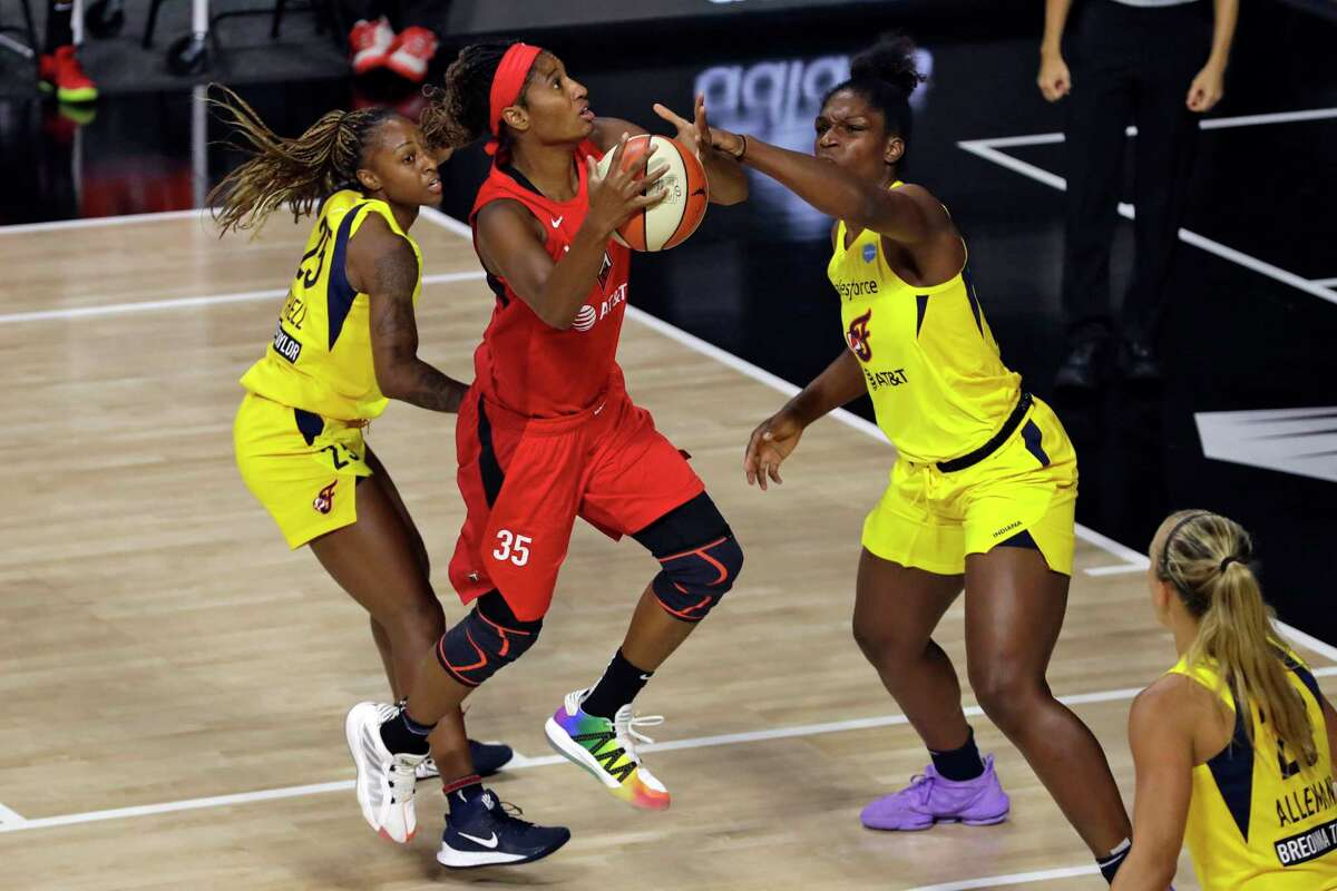 Las Vegas Aces forward Angel McCoughtry (35) shoots between Indiana Fever guard Tiffany Mitchell (25) and center Teaira McCowan (15) during the first half of a WNBA basketball game Tuesday, Aug. 11, 2020, in Bradenton, Fla. (AP Photo/Chris O'Meara)