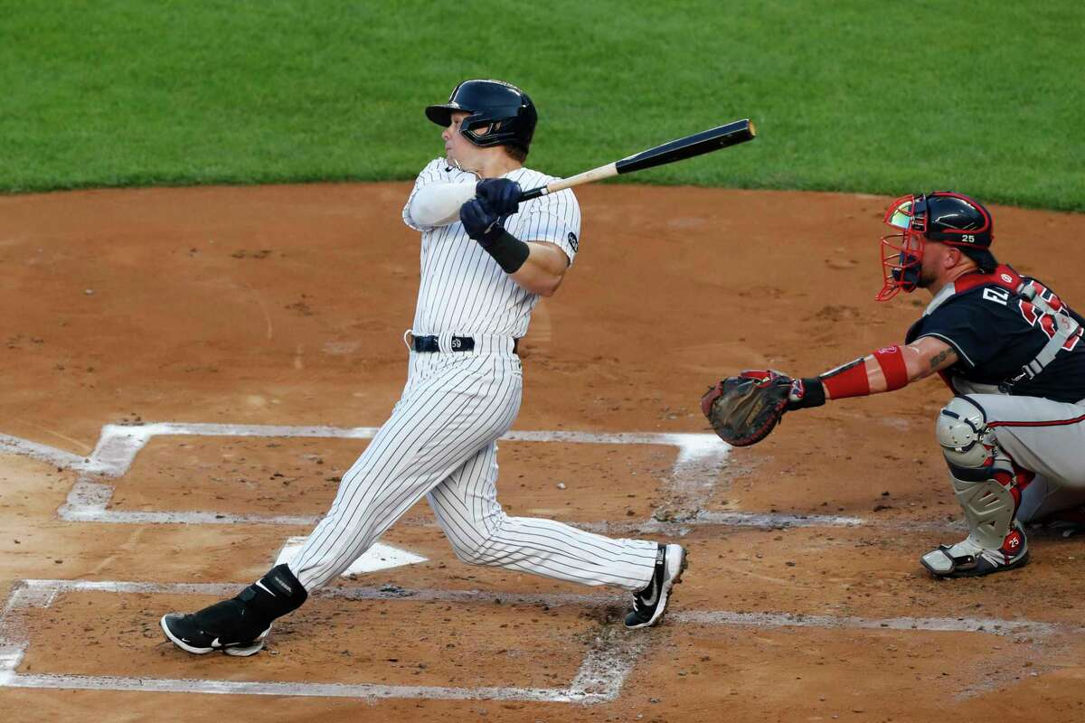 New York Yankee's first baseman Luke Voit hits a three-run, home run during the first inning of a baseball game against the Atlanta Braves, Tuesday, Aug. 11, 2020, in New York. (AP Photo/Kathy Willens)