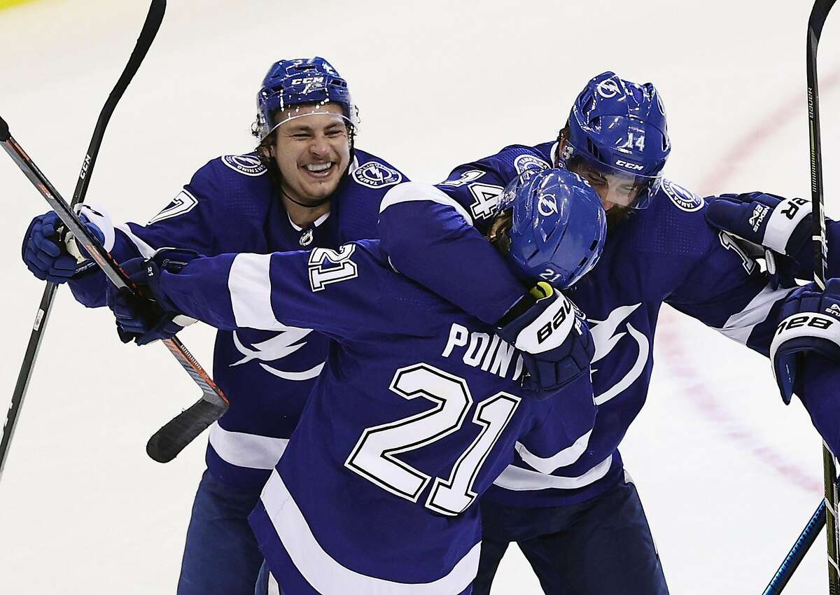 The Tampa Bay Lightning's Brayden Point (21) celebrates his game-winning goal against the Columbus Blue Jackets at 10:27 of the fifth overtime period in Game One of the Eastern Conference First Round playoff series at Scotiabank Arena in Toronto, Canada, on Tuesday, Aug. 11, 2020. The Lightning won, 3-2. (Elsa/Getty Images/TNS)