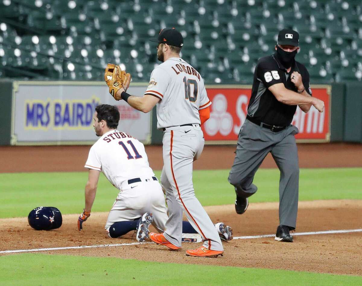 Houston Astros pinch runner Garrett Stubbs is caught stealing third base by San Francisco Giants third baseman Evan Longoria (10) to end the eighth inning of an MLB baseball game at Minute Maid Park, Tuesday, August 11, 2020, in Houston.