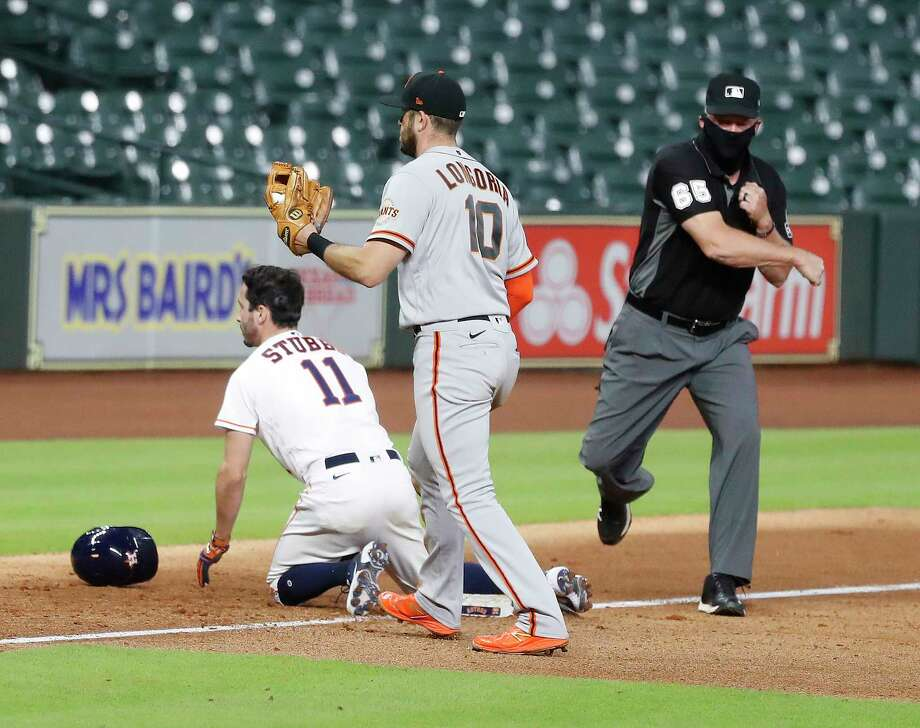 Houston Astros pinch runner Garrett Stubbs is caught stealing third base by San Francisco Giants third baseman Evan Longoria (10) to end the eighth inning of an MLB baseball game at Minute Maid Park, Tuesday, August 11, 2020, in Houston. Photo: Karen Warren, Staff Photographer / © 2020 Houston Chronicle