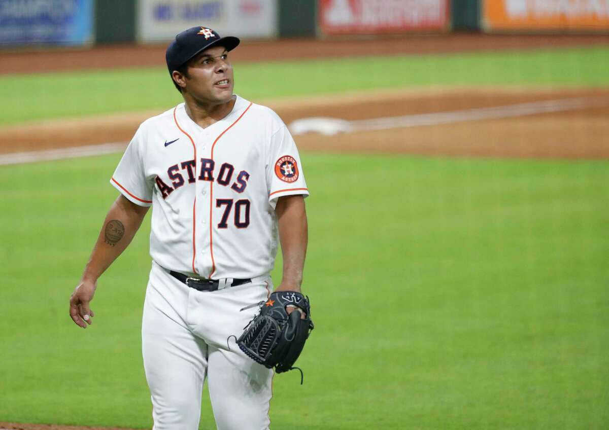 Houston Astros pitcher Andre Scrubb reacts after striking out San Francisco Giants Pablo Sandoval to end the eighth inning of an MLB baseball game at Minute Maid Park, Monday, Tuesday, August 11, 2020, in Houston.