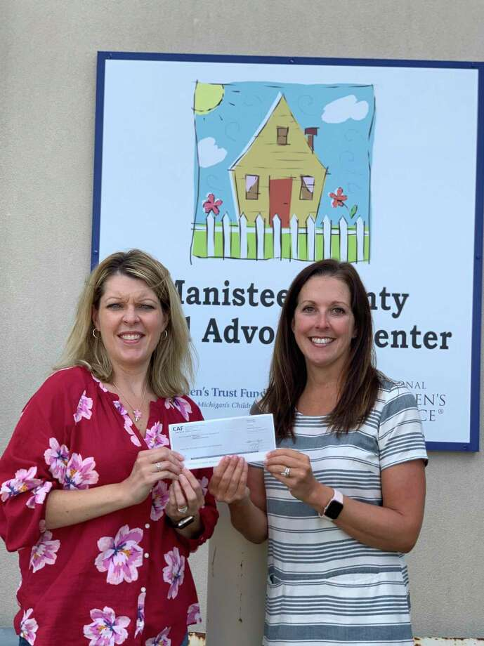 The Manistee County Child Advocacy Center's family advocate Traci Smith (left) and executive director Megan McCarthy hold a grant award check from Republic Services Foundation which will be used to provide services to child victims of abuse in Manistee County. (Courtesy Photo/Megan McCarthy)