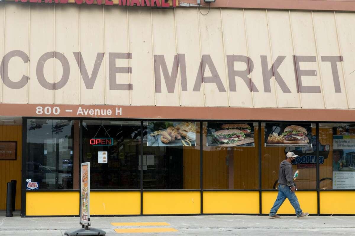 A customer leaves the Island Cove Market on Treasure Island in San Francisco, California on Aug. 11, 2020.