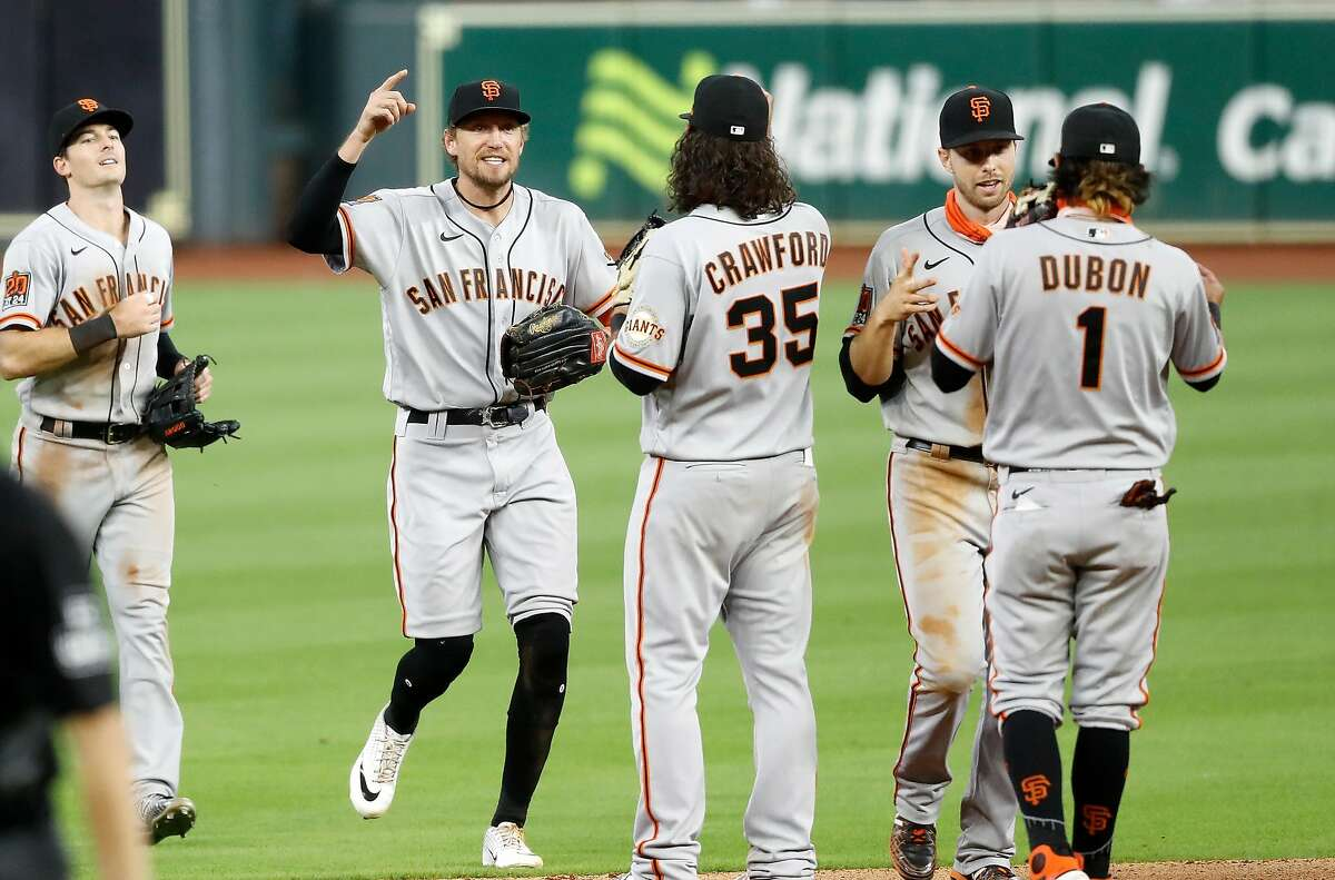 HOUSTON, TEXAS - AUGUST 11: The San Francisco Giants celebrate after defeating the Houston Astros in ten innings at Minute Maid Park on August 11, 2020 in Houston, Texas. (Photo by Tim Warner/Getty Images)