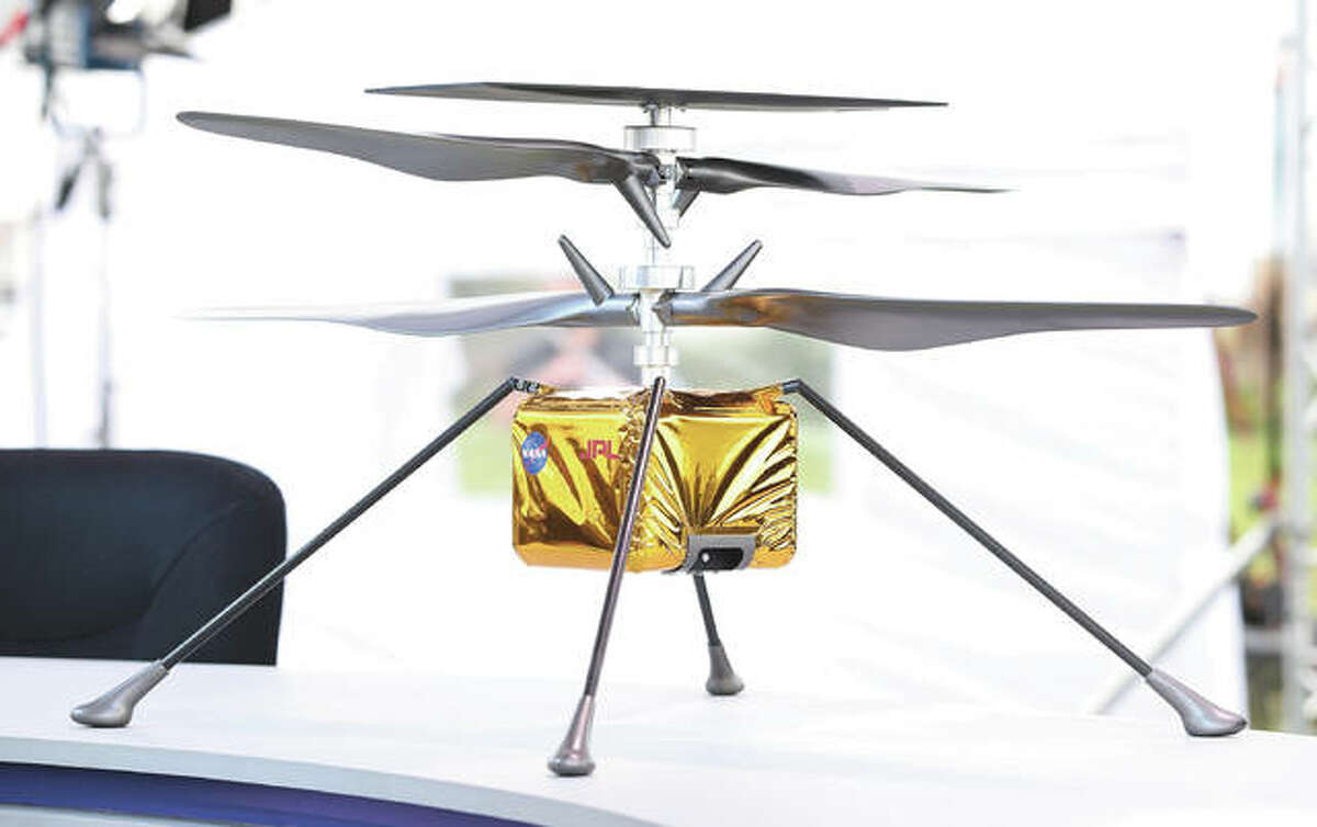 A close-up view of a full size model of the Ingenuity helicopter, which is part of the Perseverance rover. This will be the first time a drone helicopter will ever be used on another planet.