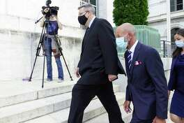 Michael Mann, left, the ex-MyPayrollHR CEO, and his attorney, Michael Koenig, enter U.S. District Court on Wednesday, Aug. 12, 2020, in Albany, N.Y. (Paul Buckowski/Times Union)