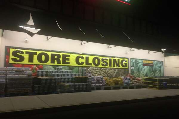 Store closing signs have been posted inside and outside Fairway Market's grocery store and wine-and-spirits store at 689-699 Canal St., in Stamford, Conn.