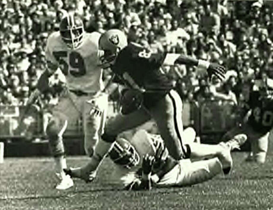 Oakland Raiders wide receiver Morris Bradshaw picks up yardage after a catch. Bradshaw, an Edwardsville High School graduate, played for Oakland from 1974 to 1981. Photo: For The Intelligencer