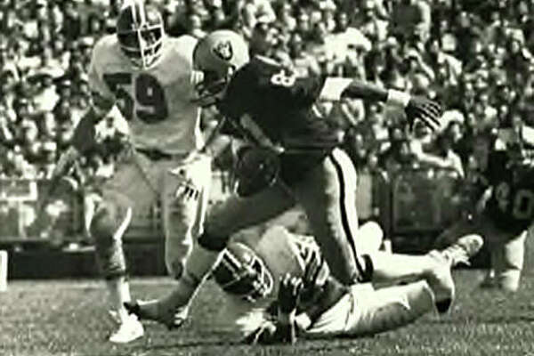 Oakland Raiders wide receiver Morris Bradshaw picks up yardage after a catch. Bradshaw, an Edwardsville High School graduate, played for Oakland from 1974 to 1981.