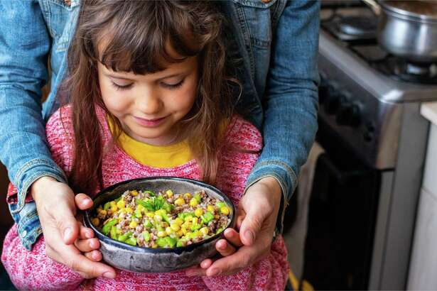 Parents and children, who may be home together during COVID-19, can make corny fun in the kitchen; this is the perfect time to teach kids how to cook, particularly if you're incorporating one of their favorite vegetables into a dish.