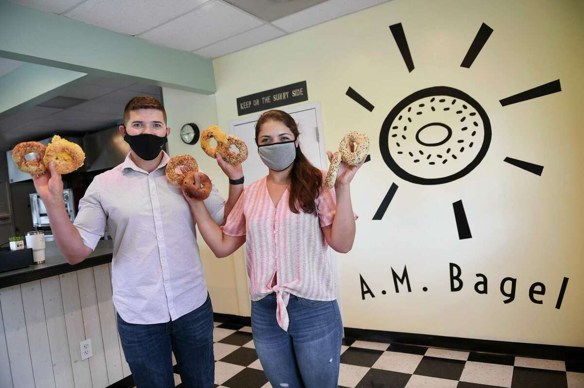Myron Seniw, left, and his fiancee, Alexis Pollina, are photographed at their business, A.M. Bagel, in Derby on Aug. 7, 2020.