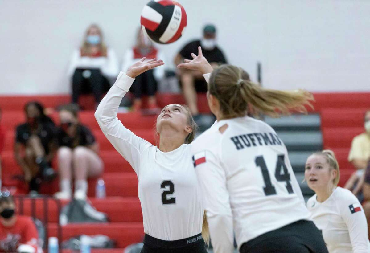 Tina Alley (2) of Hargrave returns a serve during the first set of a non-district high school volleyball match at Hargrave High School in Huffman, Tuesday, August 11, 2020.