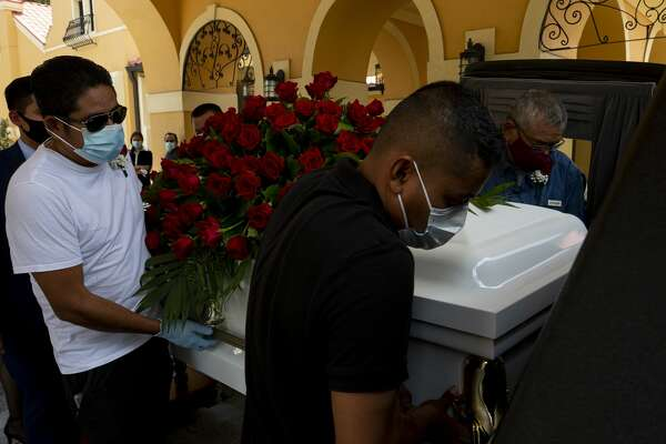 Pallbearers carry Trancito Rangel's casket into a hearse during his service at Compean Funeral Home on Aug. 4 in Houston. Rangel, 46, was a construction worker who died of COVID-19.