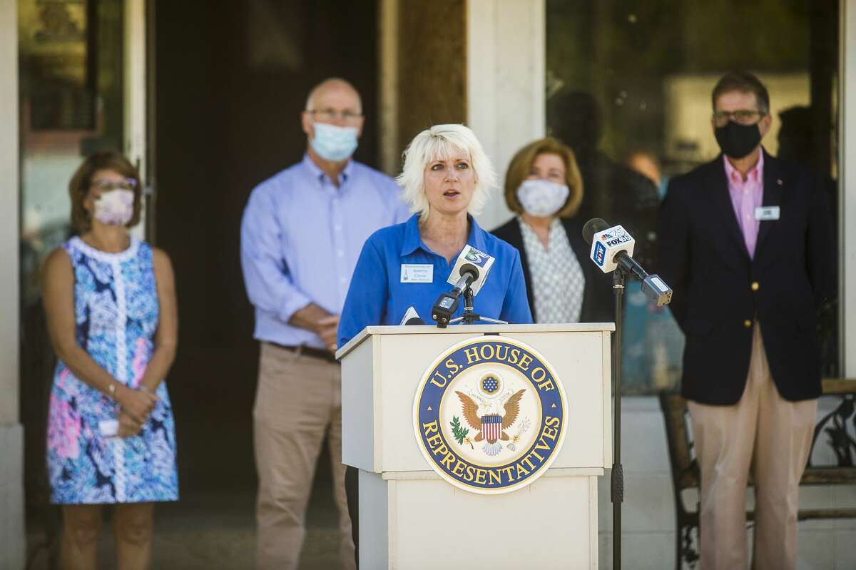 State Rep. Annette Glenn speaks during a press conference Wednesday, Aug. 12, 2020 in downtown Sanford highlighting USDA resources available for flood victims. (Katy Kildee/kkildee@mdn.net)