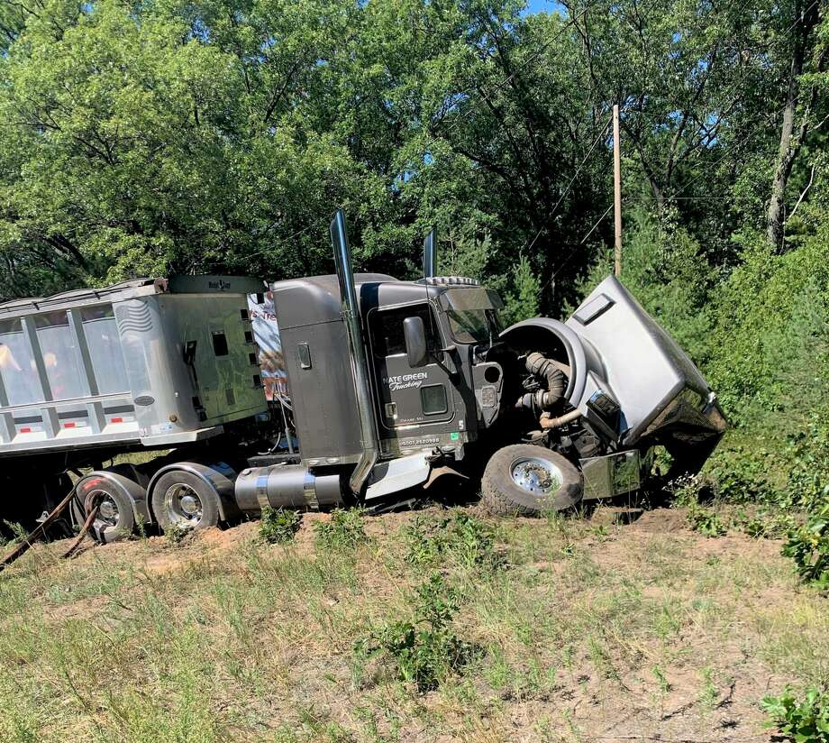 The semi-trailer was forced, as a result of the crash, and crossed over into the northbound lane and struck an SUV traveling behind the utility van on U.S. 31 on Tuesday. (MSP courtesy photo) Photo: MSP Courtesy Photo