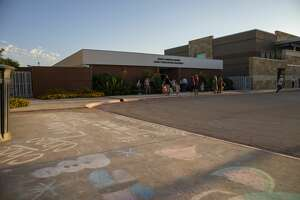 Chalk art greets students as they attend the first day back to school on Wednesday, Aug. 12, 2020 at Midland Christian.