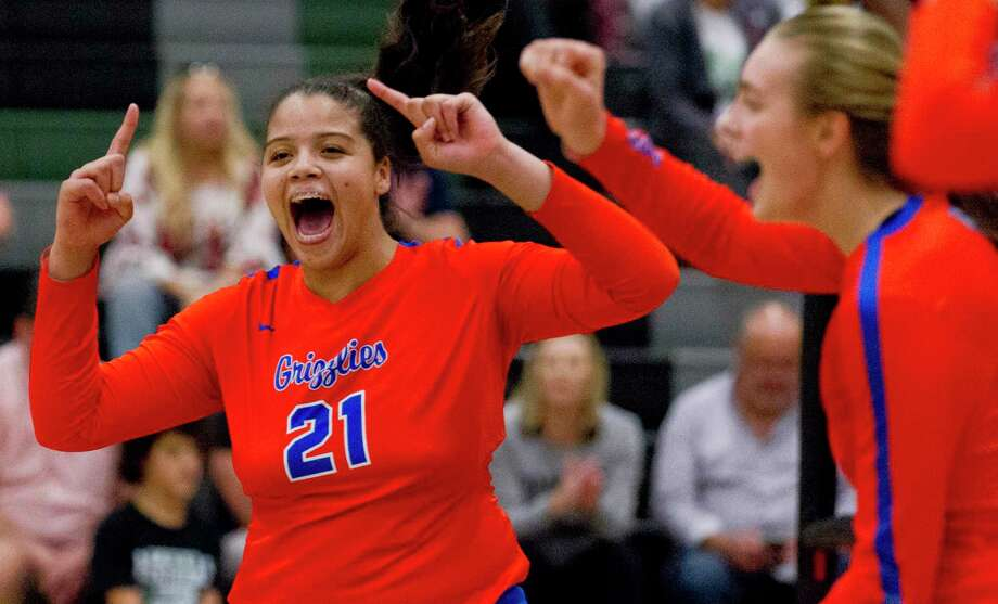 Grand Oaks outside hitter Fallon Thompson (21) reacts after scoring a point during the first set of a District 20-5A high school volleyball match at Kingwood Park High School, Tuesday, Sept. 10, 2019, in Kingwood. Photo: Jason Fochtman, Houston Chronicle / Staff Photographer / Houston Chronicle