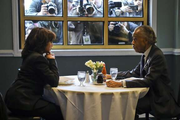Democratic presidential candidate Sen. Kamala Harris, D-Calif., left, meets with civil rights leader Rev. Al Sharpton, President of the National Action Network, during lunch at Sylvia's Restaurant in the Harlem neighborhood of New York, Thursday Feb. 21, 2019. (AP Photo/Bebeto Matthews, Pool)