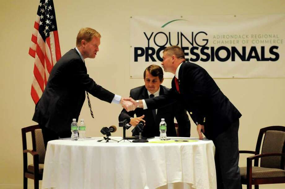 Rep. Scott Murphy, left, and candidate Chris Gibson shake hands after their first debate on Thursday, at the Hyde Collection in Glens Falls. Matthew Fuller of the Young Professionals moderated. (Cindy Schultz/Times Union) Photo: Cindy Schultz