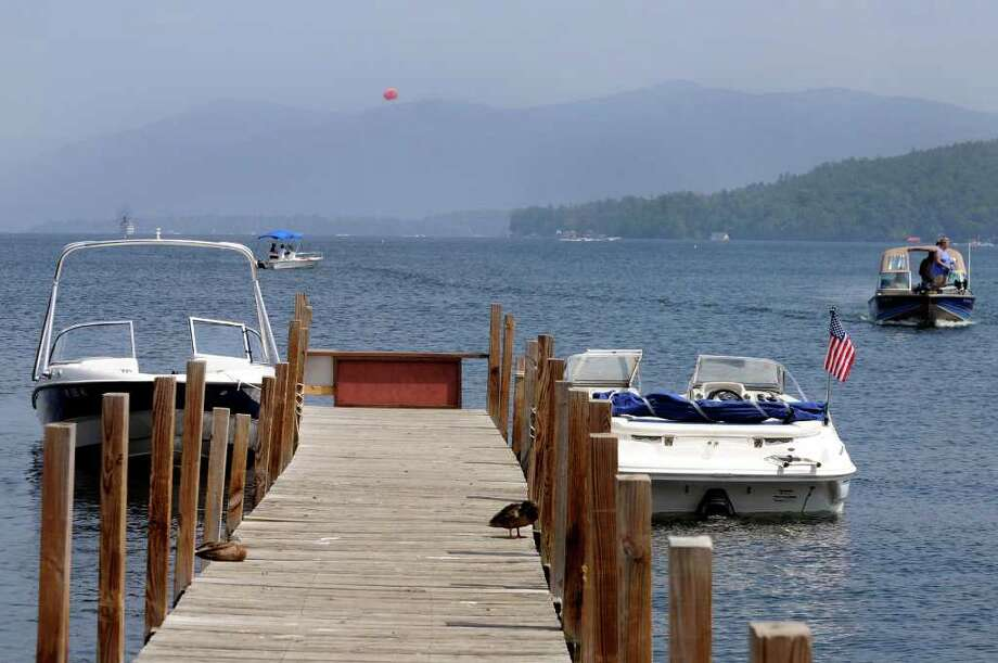 Officials suspect an invasive Asian clam has arrived in Lake George after being transported in boat bilge water or a bait pail. (Times Union) Photo: CINDY SCHULTZ