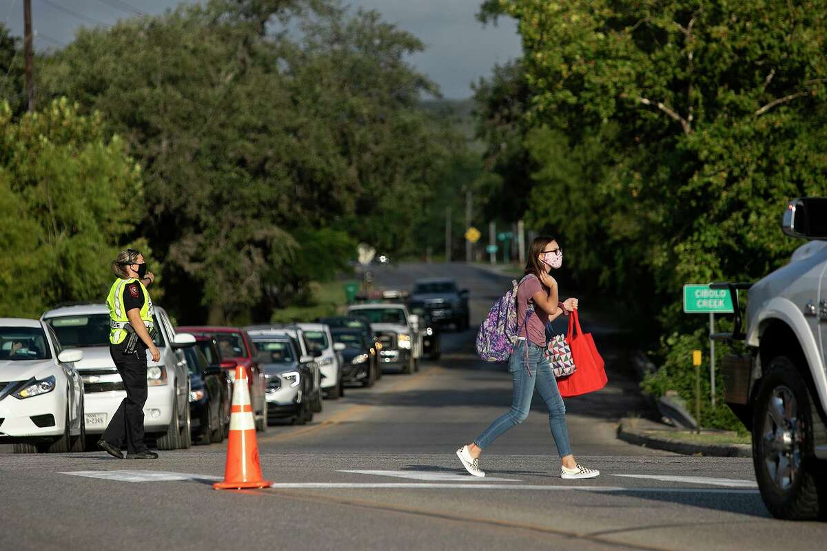 Traffic is stopped for a pedestrian crossing the street next to Boerne Middle School North on the first day of school Wednesday.