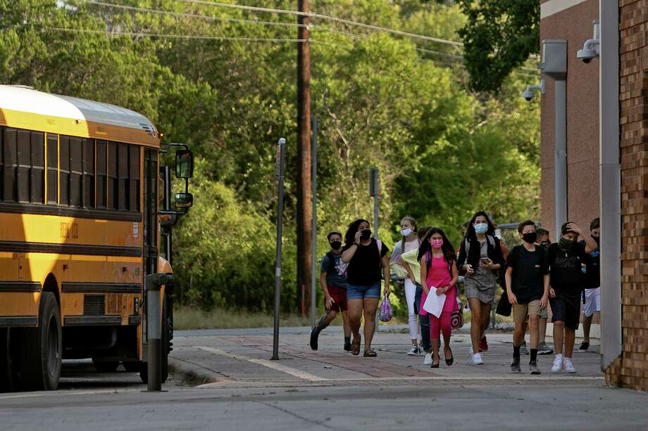 Students walk into Boerne Middle School North after they were dropped off by a school bus driver on the first day of school in Boerne on Aug. 12. Photo: Lisa Krantz /Staff Photographer / San Antonio Express-News