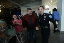 Beaumont Police Department's new officer Sheena Yarbrough jokes with her father John as she gathers with family during a milestones ceremony Tuesday at the Event Centre. Twelve new officers were sworn in, officer Cody Foote was recognized for his promotion to Sergeant, and other officer and civilian awards were presented during the event. Photo taken Tuesday, January 8, 2019 Photo by Kim Brent/The Enterprise